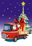 Santa Claus levererar gåvor på en röd lastbil Royaltyfri Foto