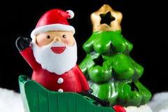Santa Claus levererar lycka i juldag Arkivbild