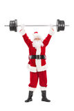 Santa Claus lifting a heavy barbell Stock Photo