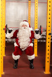Strongman - Santa Claus lifting weights in gym. Santa Claus lifting weights in gym - physical condition training before Christmas royalty free stock images