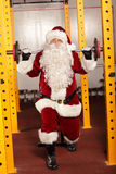Santa Claus  lifting weights in gym Royalty Free Stock Photography
