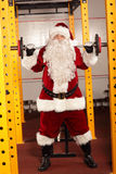 Santa Claus  lifting weights in gym Stock Images