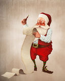 Santa Claus and the list of gifts Royalty Free Stock Photo