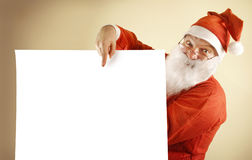Santa claus with list. Santa claus with white paper royalty free stock photo