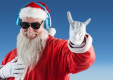 Santa claus listening music on headphones and gesturing Royalty Free Stock Photography