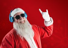 Santa claus listening music on headphones and gesturing Royalty Free Stock Photo