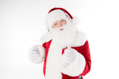 Santa Claus listening music with headphones. Happy Santa Claus listening music with headphones and dancing Royalty Free Stock Images