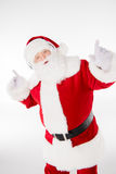 Santa Claus listening music with headphones Stock Images