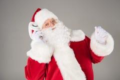 Santa Claus listening music with headphones. Happy Santa Claus listening music with headphones and posing Stock Photography