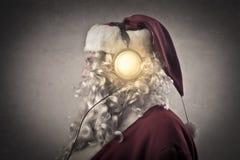 Santa Claus. Listening to music Stock Image