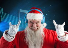 Santa claus listening to music on headphones Royalty Free Stock Images