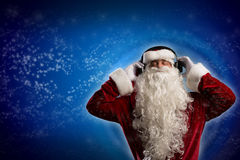 Santa Claus is listening to music Stock Image