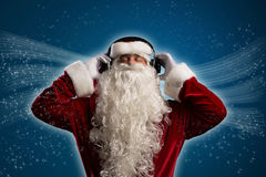 Santa Claus is listening to music Stock Photography