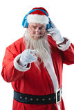 Santa claus listening to music on headphones. Portrait of santa claus listening to music on headphones against white background Royalty Free Stock Photo