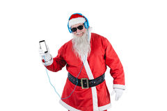 Santa claus listening to music on mobile phones. Against white background Stock Photo
