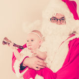 Santa claus with little baby. Royalty Free Stock Photography