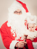 Santa claus with little baby. Royalty Free Stock Photos