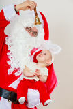 Santa claus with little baby. Royalty Free Stock Photo