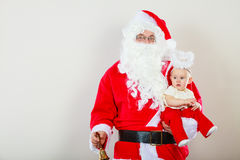 Santa claus with little baby. Stock Photography