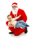 Santa Claus with little boy Stock Photo