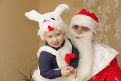 Santa Claus and little boy Stock Photos