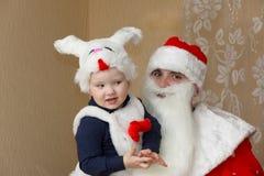 Santa Claus and little boy Stock Photos