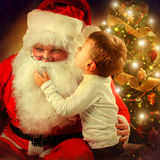 Santa Claus and Little Boy. Christmas Scene Royalty Free Stock Images