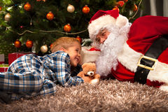 Santa Claus and a little boy royalty free stock image
