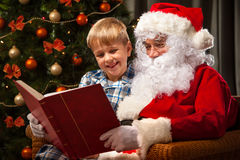 Santa Claus and a little boy Stock Image