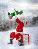 Santa Claus and little elf Royalty Free Stock Image