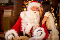 Santa Claus and Little girl Stock Images