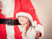 Santa claus with little girl. Royalty Free Stock Images