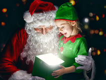 Santa Claus and little girl Stock Image