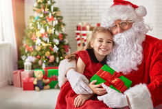 Santa Claus and little girl Royalty Free Stock Photos