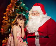 Santa Claus  and little girl holding gift Stock Photography