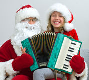 Santa Claus and little girl. Royalty Free Stock Image