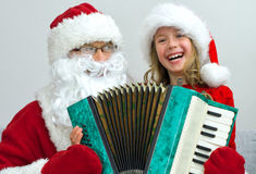 Santa Claus and little girl. Royalty Free Stock Photo