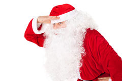 Santa Claus look far away hold hand at head Royalty Free Stock Image