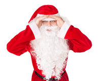 Santa Claus look far away hold hands at head Royalty Free Stock Photo