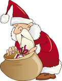 Santa Claus look in the sack. Funny Santa Claus looking at gifts in the sack Royalty Free Stock Images