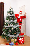 Santa Claus looking back and greeting Royalty Free Stock Image