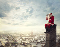 Santa Claus. Looking through a binoculars Stock Photography