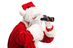 Santa Claus looking through binoculars Stock Images