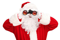 Santa Claus looking through binoculars Stock Photos