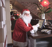 A Santa claus looking at camera in the bar Stock Photos