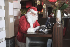 A Santa claus looking at camera in the bar Stock Photo