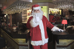 Santa claus looking at camera in the bar Royalty Free Stock Image
