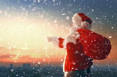 Santa Claus looking at city Royalty Free Stock Photos