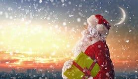 Santa Claus looking at city royalty free stock photography