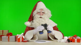 Santa Claus is Looking for Gift Ideas, Using Binoculars stock video